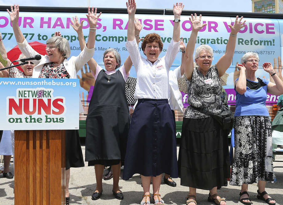 "In 2013, nuns with the Network social-justice lobby rally for immigration reform at St. Leonard Parish in San Antonio. This year, the ""Nuns on the Bus"" tour will again hit the road, holding voter registration drives as they protest the influence of unregulated campaign contributions on politics. Photo: Express-News File Photo / ©2013 San Antonio Express-News"