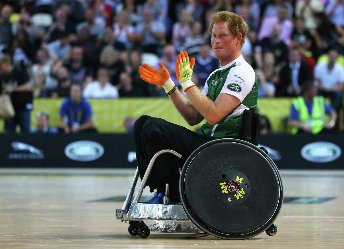 Prince Harry of Invictus applauds during the Jaguar Land Rover Exhibition Wheelchair Rugby Match during day 2 of the Invictus Games, presented by Jaguar Land Rover at the Copper Box Arena on September 12, 2014 in London, England.