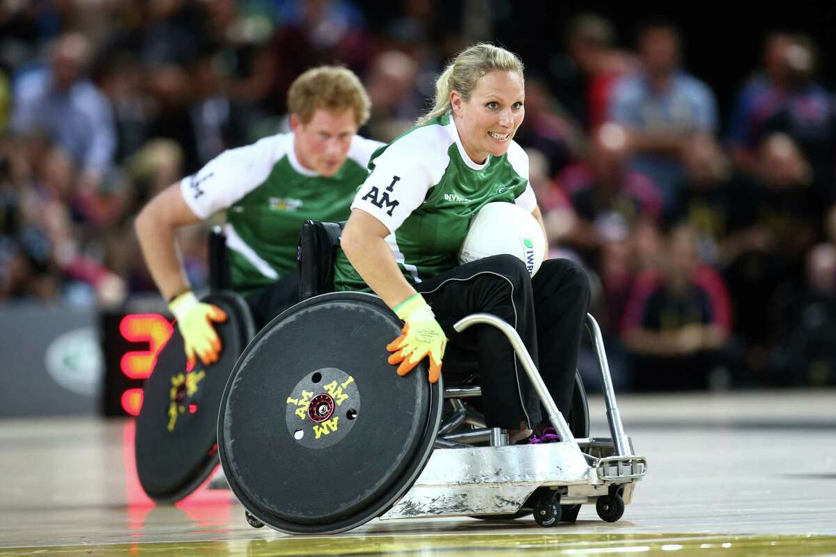 Zara Tindall and Prince Harry take part in the Jaguar Land Rover Exhibition Wheelchair Rugby match on Day Two of the Invictus Games at the Olympic Park on September 12, 2014 in London, England.