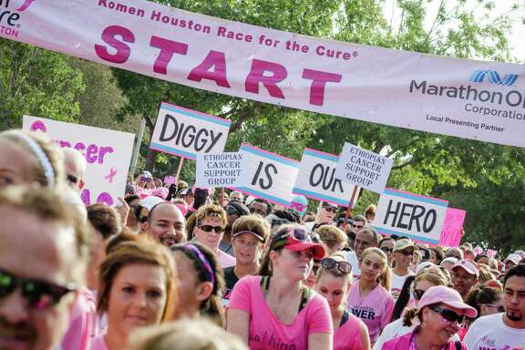 Signs showing support of those fighting breast cancer - past and present - lined the Komen Race For the Cure last year in Houston.