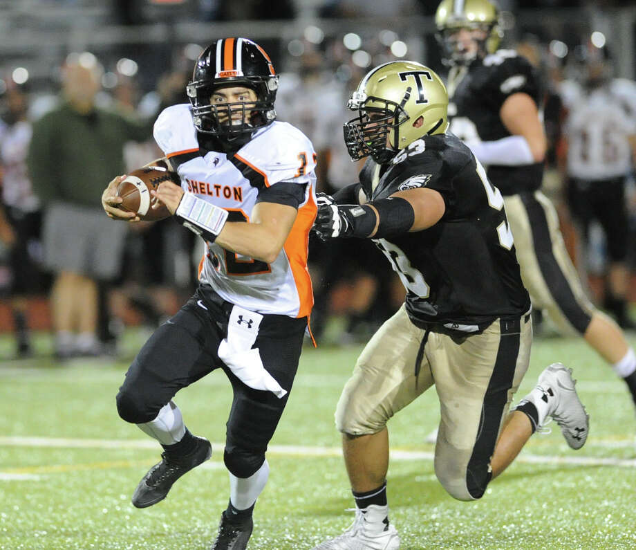 The senior QB generated 322 total yards and 5 TDs to spearhead 40-10 defeat of Trumbull. Photo: Bob Luckey / Greenwich Time