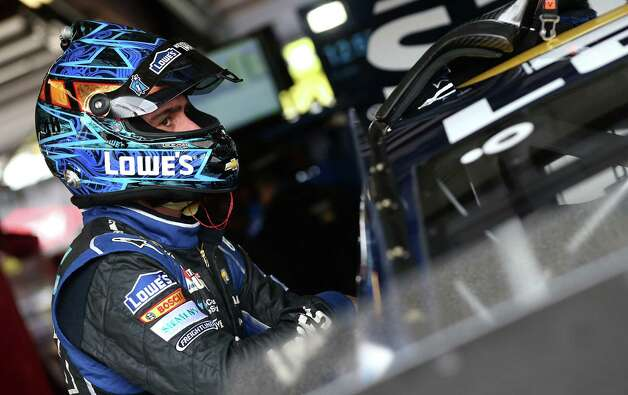 JOLIET, IL - SEPTEMBER 12:  Jimmie Johnson, driver of the #48 Lowe's Chevrolet, stands in the garage area during practice for the NASCAR Sprint Cup Series MyAFibStory.com 400 at Chicagoland Speedway on September 12, 2014 in Joliet, Illinois.  (Photo by Sarah Glenn/Getty Images) ORG XMIT: 512368967 Photo: Sarah Glenn / 2014 Getty Images