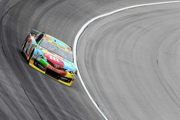 JOLIET, IL - SEPTEMBER 12:  Kyle Busch, driver of the #18 M&M's Toyota, practices for the NASCAR Sprint Cup Series MyAFibStory.com 400 at Chicagoland Speedway on September 12, 2014 in Joliet, Illinois.  (Photo by Nick Laham/Getty Images) ORG XMIT: 512368967 Photo: Nick Laham / 2014 Getty Images