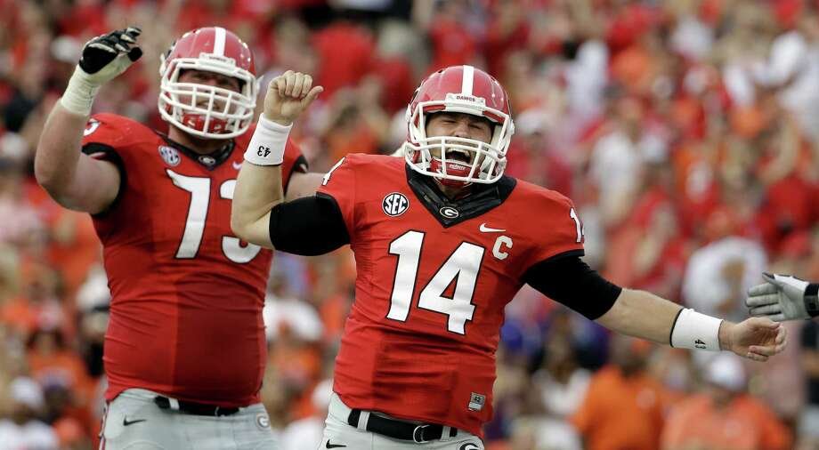 QB Hutson Mason (right) and Georgia have not played since a big victory over Clemson to open the season Aug. 30. Photo: David Goldman / Associated Press / AP