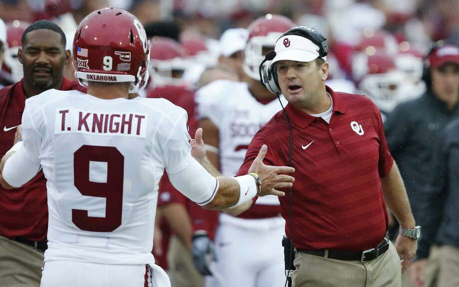 Oklahoma coach Bob Stoops (right) and quarterback Trevor Knight, a Reagan grad, can make a statement on behalf of the Big 12 in today's matchup against SEC opponent Tennessee. Photo: Sue Ogrocki / Associated Press / AP