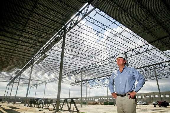 Trey Odom, head of Houston-based Avera, looks over a giant warehouse his company is building in Pasadena.