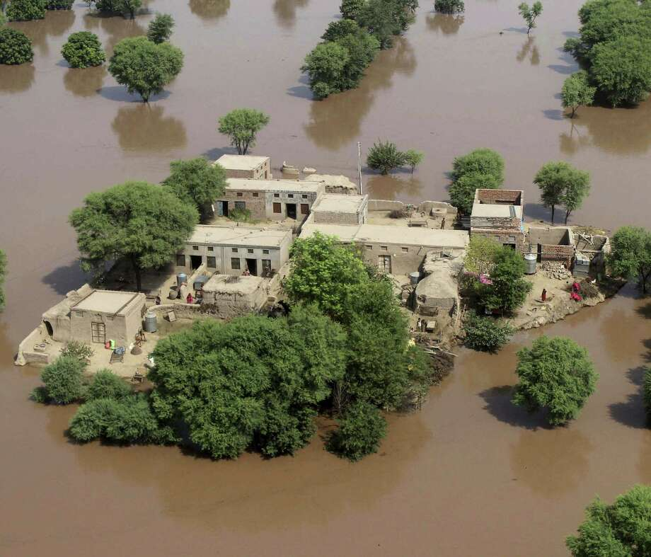 An aerial view shows houses surrounded by floodwaters in Multan. Pakistan's military has expanded the rescue and relief operations in Punjab province. Photo: Mansoor Abass / Associated Press / AP