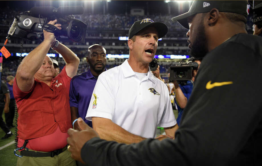 Ravens coach John Harbaugh and Steelers coach Mike Tomlin (right) meet after Thursday night's highly rated game on CBS. Photo: Nick Wass, FRE / Associated Press / FR67404 AP