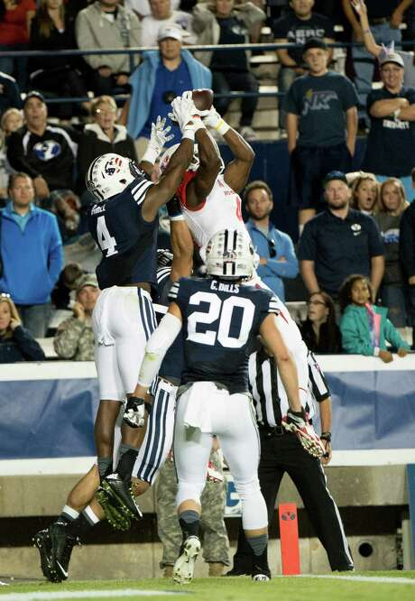 Daniel Spencer's highlight reel contribution was a Hail Mary catch at BYU that came with a high degree of difficulty. Photo: Jay Drowns, Stringer / 2014 Getty Images