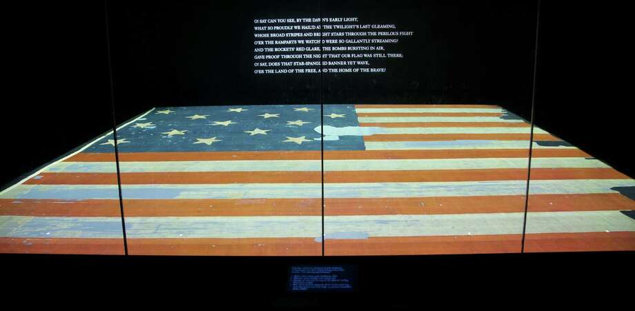 The Star-Spangled Banner is at the Smithsonian's National Museum of American History, kept in a chamber that keeps oxygen and lighting very low and temperature and humidity constant. It should last for generations more. Photo: Pablo Martinez Monsivais / Associated Press / AP