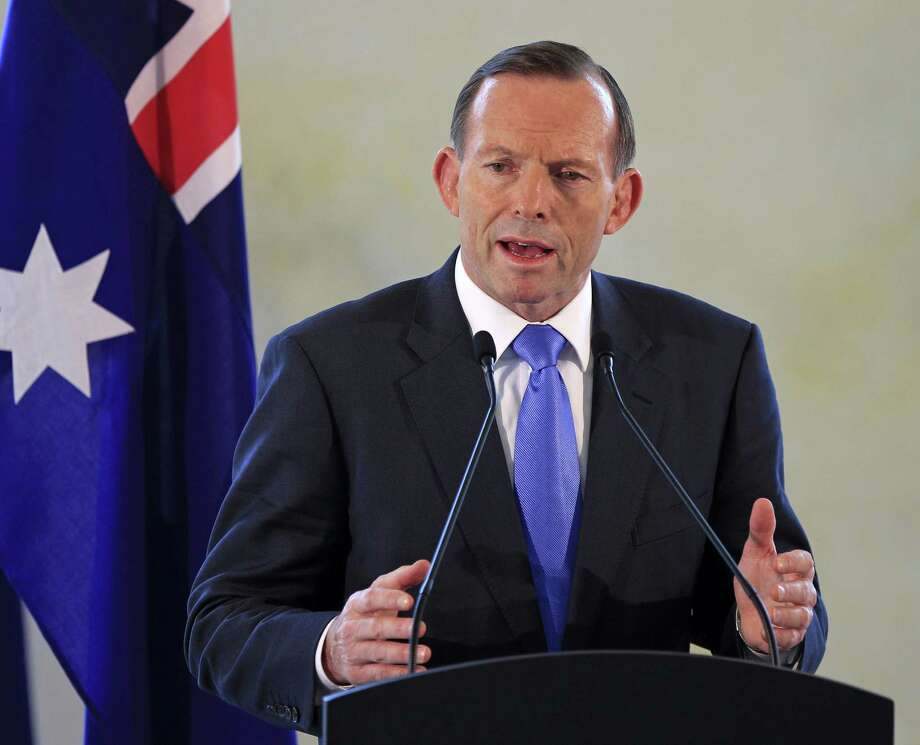 Tony Abbott, heeding warnings from security officials that a growing number of Australians are joining extremist groups, raises the country's terrorism alert level. Photo: Lai Seng Sin / Associated Press / AP