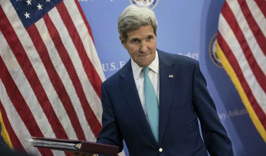 John Kerry, leaving a press conference in Ankara, Turkey, is opposed to coordinating with Iran in attacking ISIS. Photo: BRENDAN SMIALOWSKI, Associated Press / POOL afp