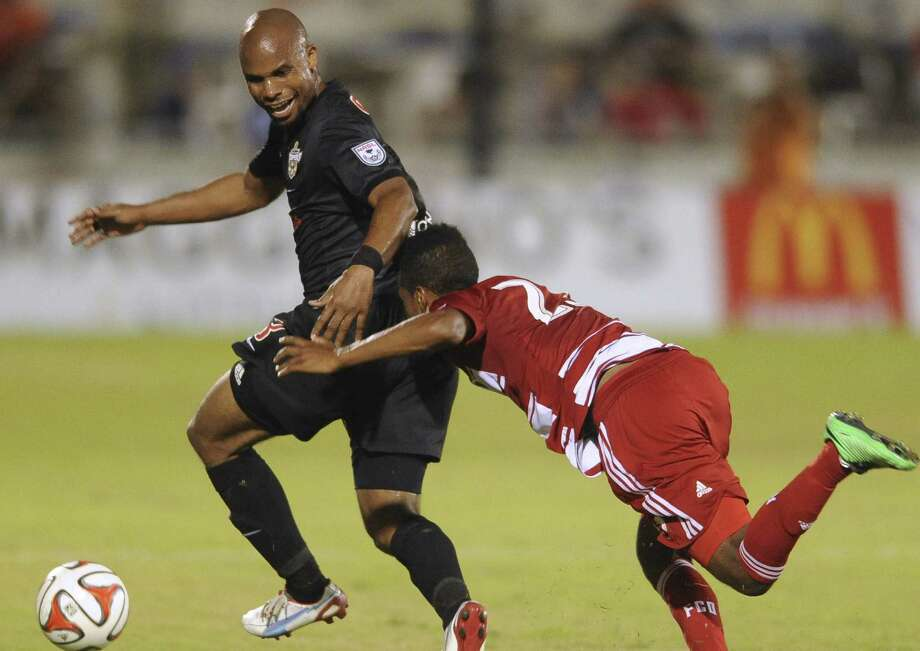 "Scorpions center back Julius James (left) pulls no punches when he's on the field, and that includes his own teammates. ""He's just a competitor,"" right back Jonathan Borrajo said. Photo: Billy Calzada, San Antonio Express-News / San Antonio Express-News"