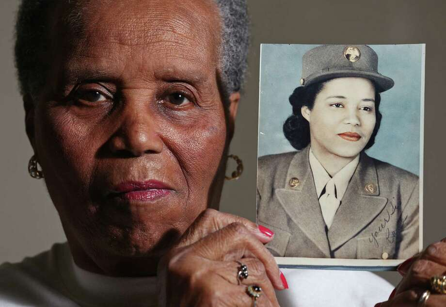 Rose Witherspoon Spence, 91, holds a World War II-vintage photo of herself in the Women's Army Corps. Photo: Edward A. Ornelas / San Antonio Express-News / © 2014 San Antonio Express-News