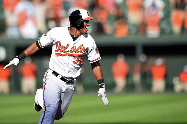 BALTIMORE, MD - SEPTEMBER 12: Jimmy Paredes #38 of the Baltimore Orioles celebrates his game-winning RBI double in the eleventh inning against the New York Yankees during game one of a doubleheader at Oriole Park at Camden Yards on September 12, 2014 in Baltimore, Maryland. The Baltimore Orioles won, 2-1, in the eleventh inning. (Photo by Patrick Smith/Getty Images) ORG XMIT: 509691115 Photo: Patrick Smith / 2014 Getty Images
