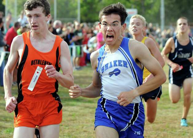 Shaker's Tom Hale, center, fights his way to the finish line during the Springstead Invitational Cross Country Meet on Friday, Sept. 12, 2014, at Colonie Town Park in Colonie, N.Y. (Cindy Schultz / Times Union) Photo: Cindy Schultz / 00028531A