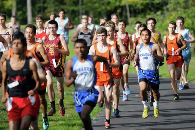 Varsity boys start their race during the Springstead Invitational Cross Country Meet on Friday, Sept. 12, 2014, at Colonie Town Park in Colonie, N.Y. (Cindy Schultz / Times Union) Photo: Cindy Schultz / 00028531A