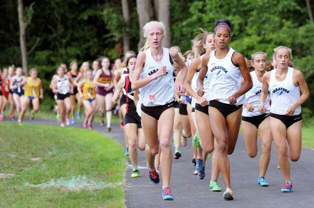 Varsity girls begin the Springstead Invitational Cross Country Meet on Friday, Sept. 12, 2014, at Colonie Town Park in Colonie, N.Y. (Cindy Schultz / Times Union) Photo: Cindy Schultz / 00028531A