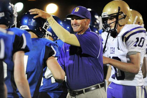CBA's Joe Burke, center, is all smiles after his team wins 35-0 in their football game against La Salle on Friday, Sept. 12, 2014, at La Salle Institute in Troy, N.Y. (Cindy Schultz / Times Union) Photo: Cindy Schultz / 00028564A
