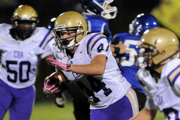 CBA's Dom Herald, center, carries the ball during their football game against La Salle on Friday, Sept. 12, 2014, at La Salle Institute in Troy, N.Y. (Cindy Schultz / Times Union) Photo: Cindy Schultz / 00028564A