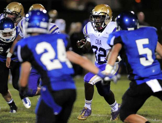 CBA's Quinten Hall, center, carries the ball during their football game against La Salle on Friday, Sept. 12, 2014, at La Salle Institute in Troy, N.Y. (Cindy Schultz / Times Union) Photo: Cindy Schultz / 00028564A