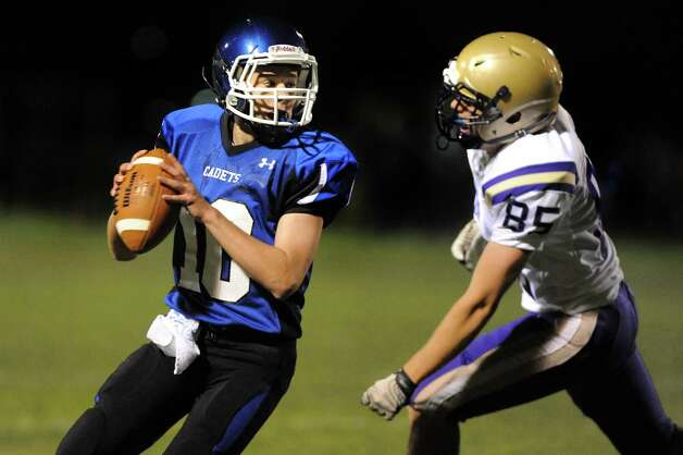 La Salle's quarterback Jack Field, left, gets pressure from CBA's Hanover Dill during their football game on Friday, Sept. 12, 2014, at La Salle Institute in Troy, N.Y. (Cindy Schultz / Times Union) Photo: Cindy Schultz / 00028564A