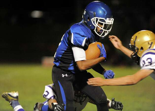 La Salle's Leon Wilson II, center, carries the ball during their football game against CBA on Friday, Sept. 12, 2014, at La Salle Institute in Troy, N.Y. (Cindy Schultz / Times Union) Photo: Cindy Schultz / 00028564A