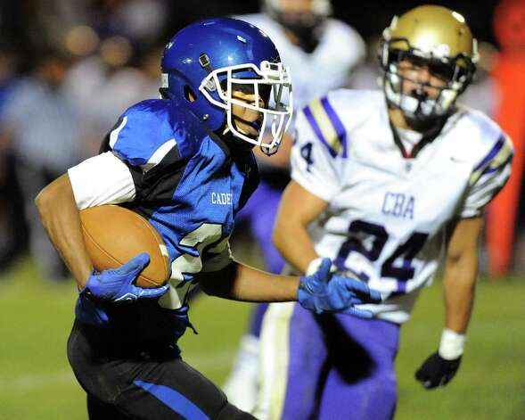 La Salle's Leon Wilson II, left, carries the ball during their football game against CBA on Friday, Sept. 12, 2014, at La Salle Institute in Troy, N.Y. (Cindy Schultz / Times Union) Photo: Cindy Schultz / 00028564A