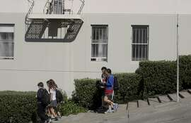 Kids walk down Fillmore st., where there are steps needed to help people walk up and down the hill into the Marina area from the Pac Heights on Fillmore st. in San Francisco, Calif., on Friday, September 12, 2014.