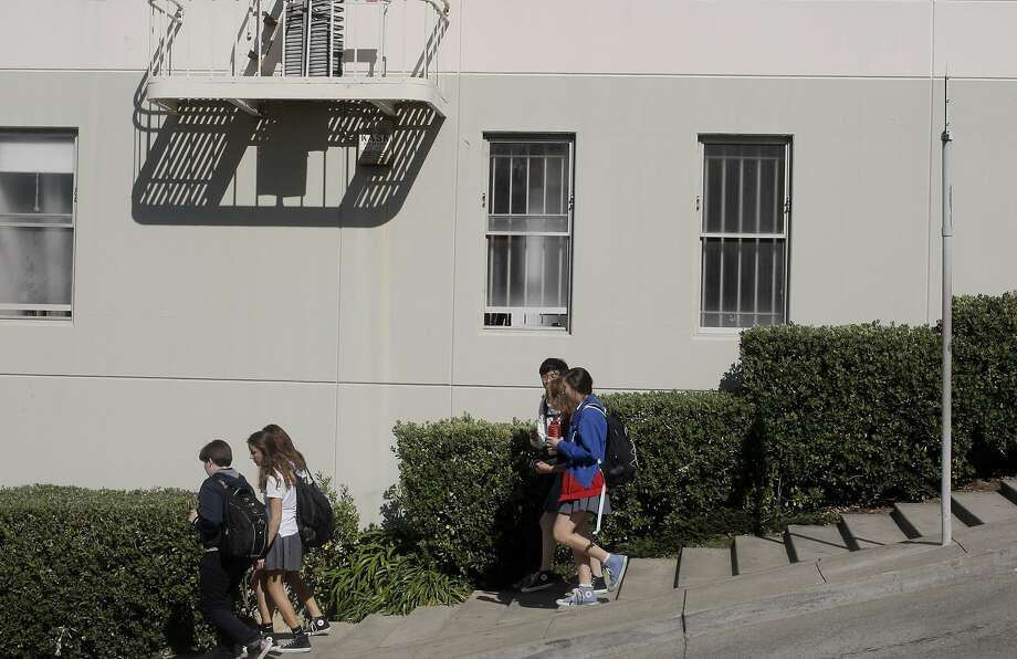 Children walk down Fillmore Street's sidewalk steps, placed there to ease the descent into the Marina. Photo: Daniel E. Porter, The Chronicle