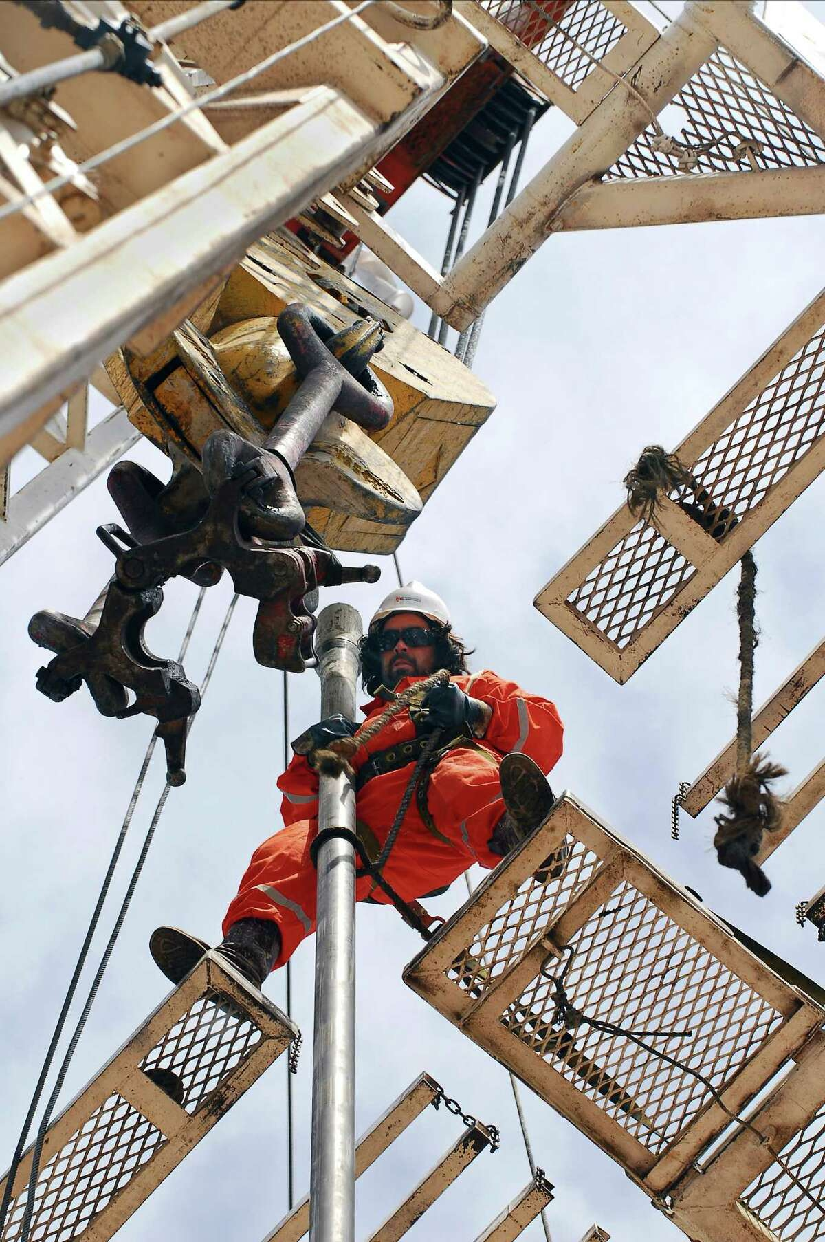 """An oil worker adjusts a drill in the province of Neuquén, Argentina. """"The Neuquén Basin has infrastructure, has rail, has roads, has pipelines,"""" says Melissa Stark."""