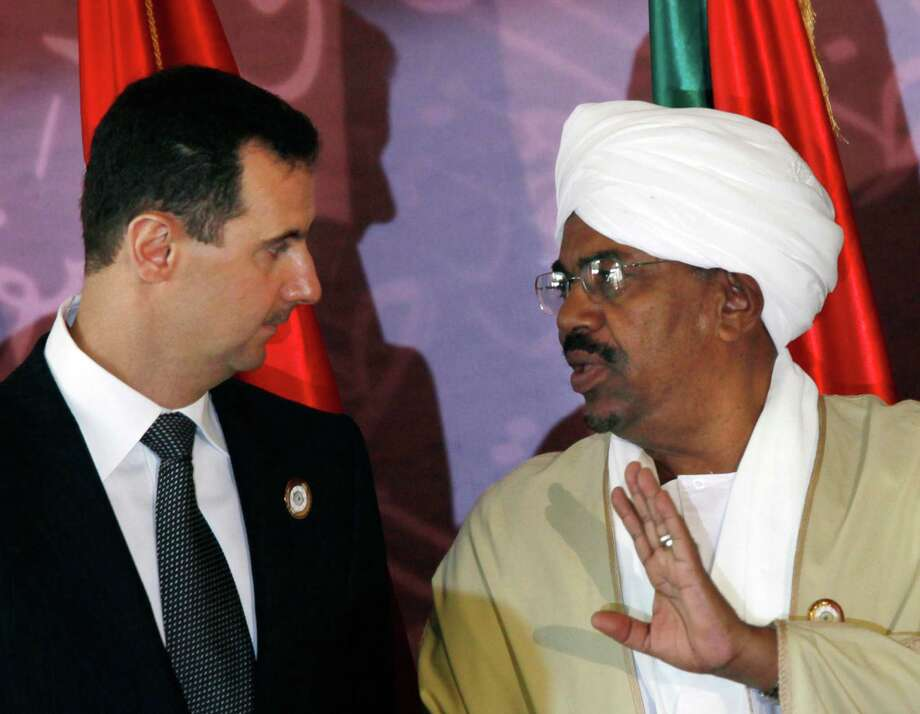 Syrian President Bashar Assad (left) talks with his Sudanese counterpart, Omar al-Bashir. Photo: Associated Press / File Photo / AP