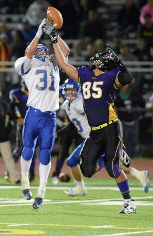 Queensbury's Erik Wettersten (31) defends against Troy's Isaiah Thomas while trying to catch a tiped pass during the first half of their Section II Class A football game on Friday, Sept. 12, 2014, in Troy , N.Y., (Hans Pennink / Special to the Times Union) ORG XMIT: HP110 Photo: Hans Pennink / Hans Pennink
