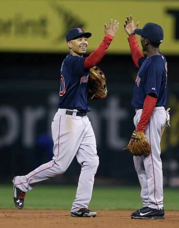 KANSAS CITY, MO - SEPTEMBER 12:  Mookie Betts #50 of the Boston Red Sox and Jemile Weeks #7 celebrates a 4-2 win over the Kansas City Royals at Kauffman Stadium on September 12, 2014 in Kansas City, Missouri. (Photo by Ed Zurga/Getty Images) ORG XMIT: 477589799 Photo: Ed Zurga / 2014 Getty Images