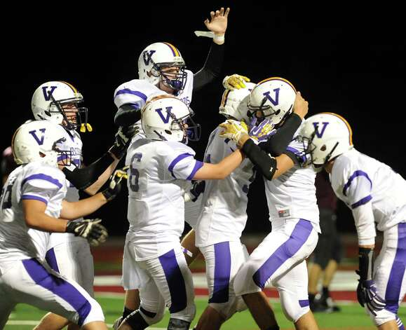 Voorheesville celebrates a first-half touchdown by Mickey Knight, second from right, during their football game against Watervliet on Friday, Sept. 12, 2014, at Watervliet High in Watervliet, N.Y. (Cindy Schultz / Times Union) Photo: Cindy Schultz / 00028563A