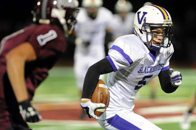 Voorheesville's Shane Parry, right, carries the ball as during their football game against Watervliet on Friday, Sept. 12, 2014, at Watervliet High in Watervliet, N.Y. (Cindy Schultz / Times Union) Photo: Cindy Schultz / 00028563A