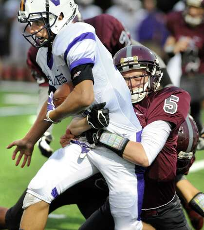 Voorheesville's quarterback Robert Denman, left, gains yards as Watervliet's Collin Murray makes the tackle during their football game on Friday, Sept. 12, 2014, at Watervliet High in Watervliet, N.Y. (Cindy Schultz / Times Union) Photo: Cindy Schultz / 00028563A