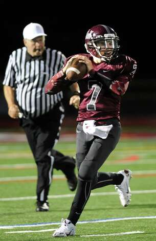 Watervliet's quarterback Anthony Halpin, right, looks for an open man during their football game against Voorheesville on Friday, Sept. 12, 2014, at Watervliet High in Watervliet, N.Y. (Cindy Schultz / Times Union) Photo: Cindy Schultz / 00028563A