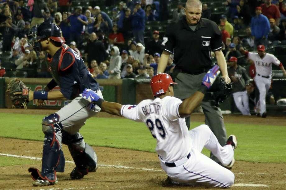 The Rangers' Adrian Beltre scores on an eighth-inning single by Robinson Chirinos. Photo: Tony Gutierrez / Associated Press / AP