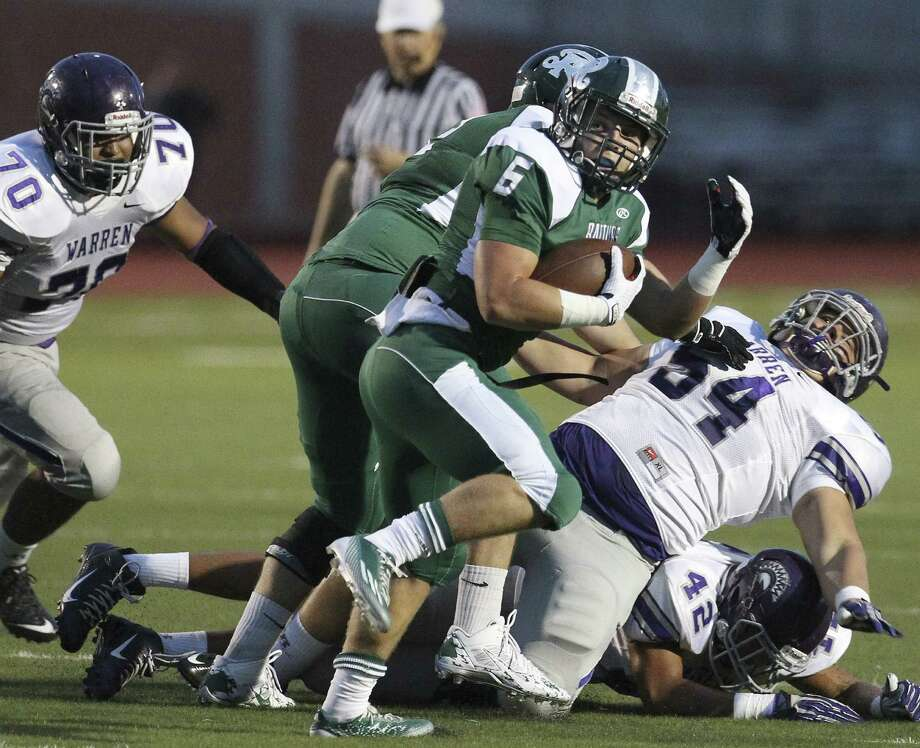Reagan's Skyler Wetzel (6), getting some running room thanks to a teammate, rushed for 167 yards on 11 carries — all in the first half — during the Rattlers' easy win Friday. Photo: Kin Man Hui, San Antonio Express-News / ©2014 San Antonio Express-News