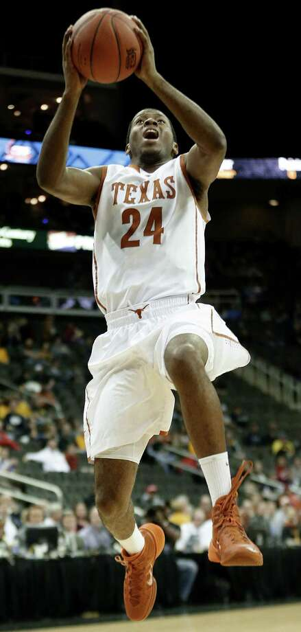 UT coach Rick Barnes suspended Martez Walker after he was charged in the assault of his girlfriend. Photo: Charlie Riedel / Associated Press / AP