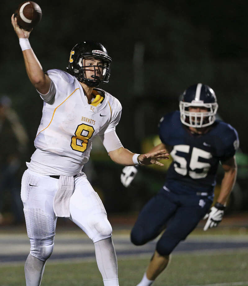 Hornet quarterback Justin Upshaw Mendoza finds a receiver in the first half as Smithson Valley hosts East Central at Ranger  Stadium on September 12, 2014. Photo: TOM REEL, By Tom Reel, San Antonio Express-News