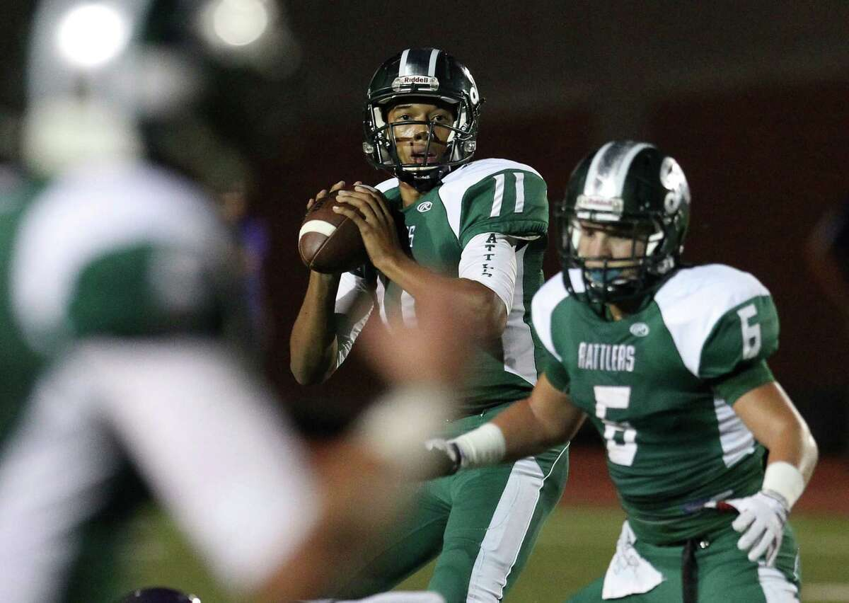 Reagan quarterback Kellen Mond (11) stays the in pocket to attempt a pass against Warren during their game at Heroes Stadium on Friday, Sept. 12, 2014.