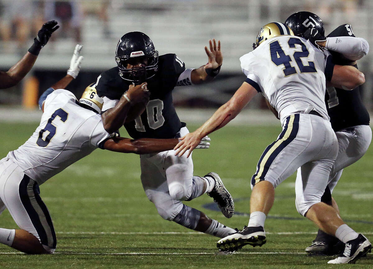 Steele's LG Williams looks for room between O'Connor's Ronnie Zuniga (left) and Kody Fields during first half action Friday Sept. 12, 2014 at Lehnhoff Stadium.