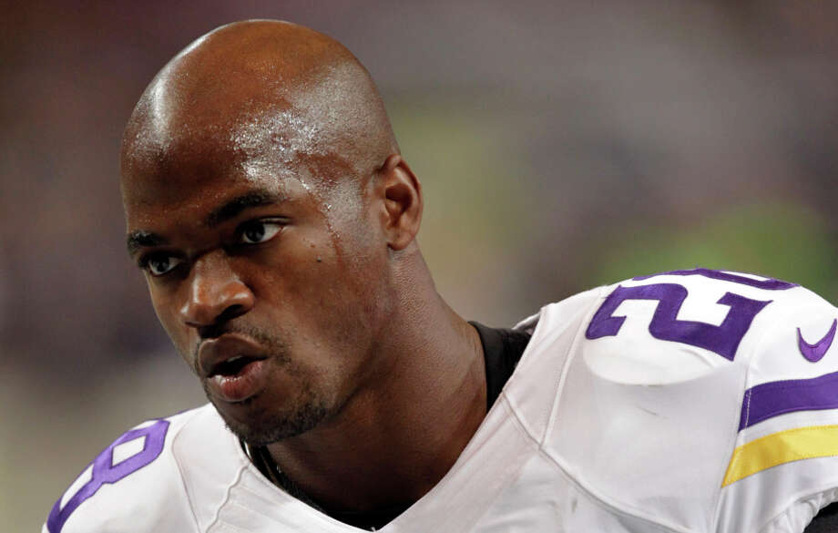 Adrian Peterson is accused of injuring his son with a switch in Texas. Photo: Tom Gannam, FRE / Associated Press / FR45452 AP