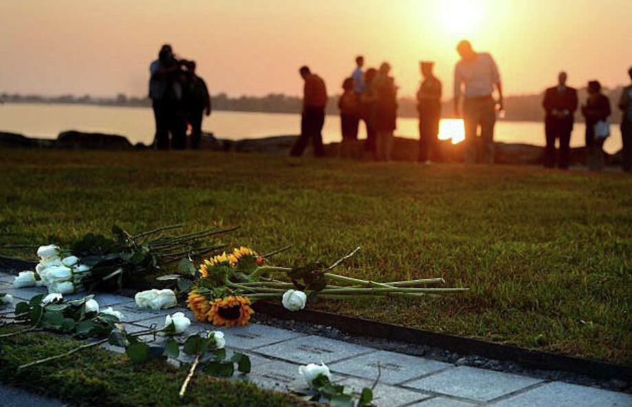 "The sun sets over the memorial to state victims of the Sept. 11, 2001, terrorist attacks at Sherwood Island State Park in Westport. On the anniversary of that tragic day, columnist Dan Woog writes: ""So much remains to be sorted out. We will hear, in the days to come, of Westporters who have lost family members and friends in the World Trade Center. We will hear too of those who have lost their jobs when their companies collapsed, either directly or indirectly, as a result of the terrorism ... Our world has already changed, in ways that will take years, if not decades, to understand. We are nowhere close to comprehending the meaning of all this."" Photo: File Photo / Westport News"