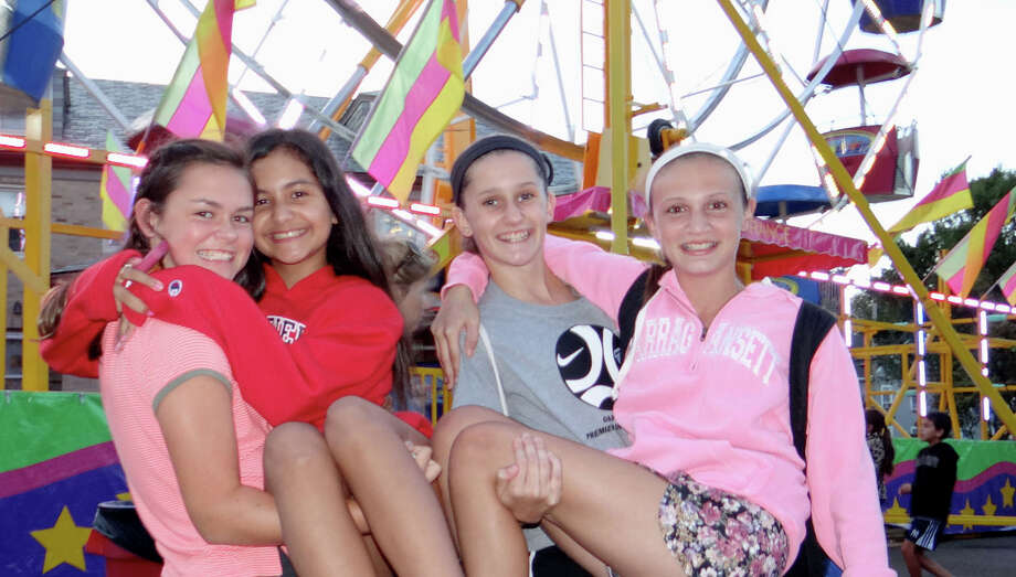 Eloise Gacetta, Andrea Melgar, Jenna Wright and Lindsay Sabia, all 11 years old, enjoying fun at Septemberfest at Our Lady of the Assumption parish. Photo: Mike Lauterborn / Fairfield Citizen