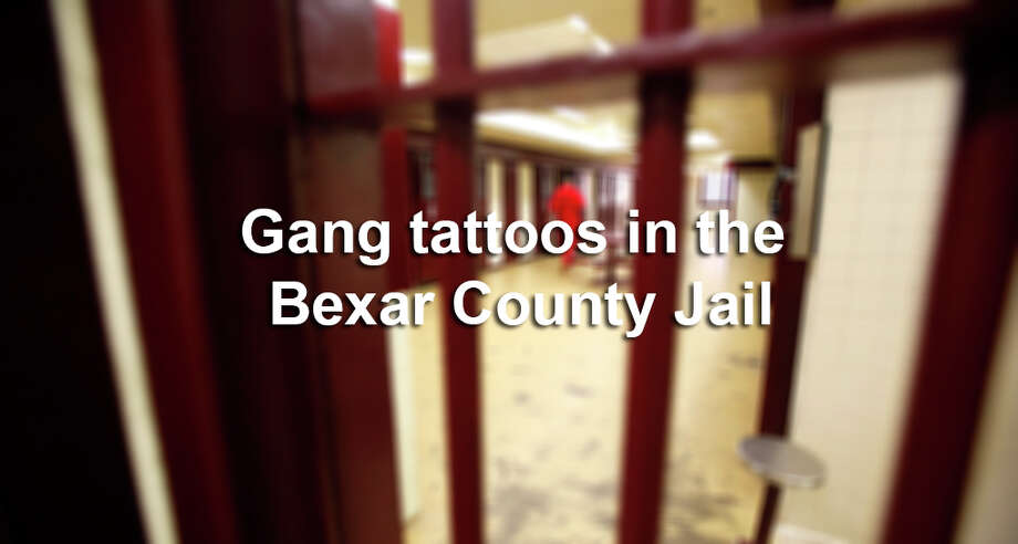 The following photos, provided by the Bexar County District Attorney's Office, identify tattoos used by gangs to demonstrate their affiliations. Photo: William Luther, Express-News File Photo / © 2012 San Antonio Express-News