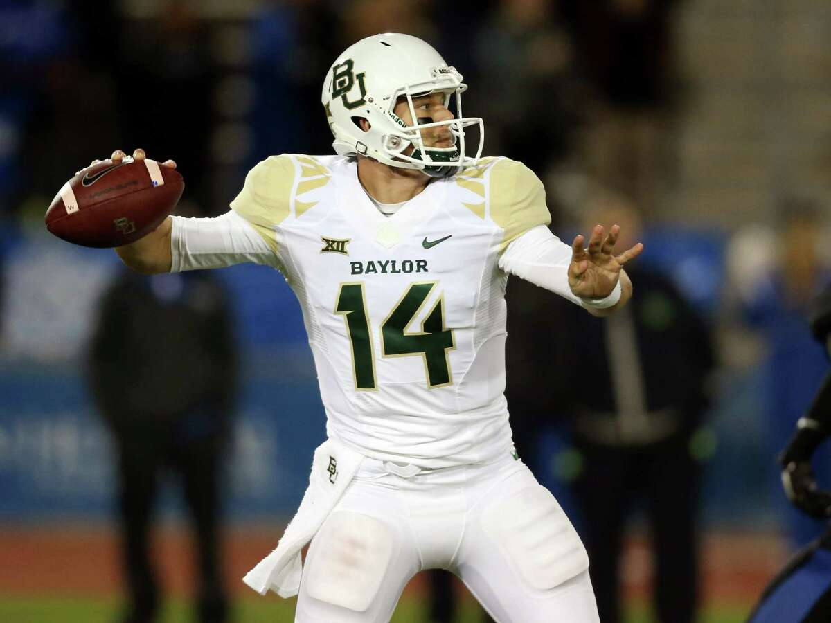 Baylor quarterback Bryce Petty (14) passes against Buffalo during the second half of an NCAA college football game on Friday, Sept. 12, 2014, in Amherst, N.Y.