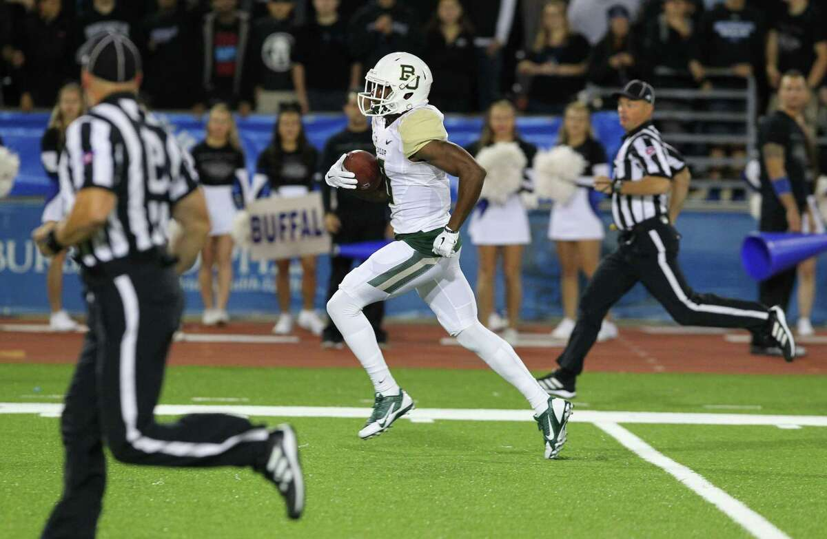 Baylor wide receiver KD Cannon (9) runs after a catch for a touchdown during the first half of an NCAA college football game against Buffalo on Friday, Sept. 12, 2014, in Amherst, N.Y.